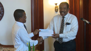 His Excellency the President Charles Savarin Issuing the Cheque to The Minister of Education