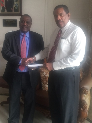 Presentation of Cheque by GM of the AID Bank Julius J. Corbett